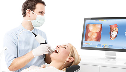 Dentist views smile with CEREC software