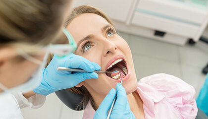 Female patient examined by the dentist