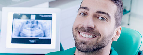 Smiling man relaxed in dental office