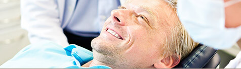 Male patient smiling in dental chair