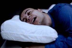Man sleeping with mouth open.