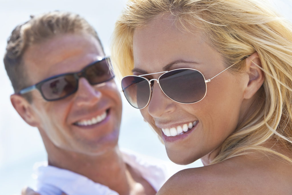 tanned couple with whitened teeth