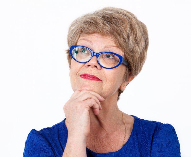 older woman smiling blue glasses