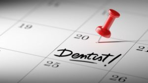 dentist appointment written on calendar