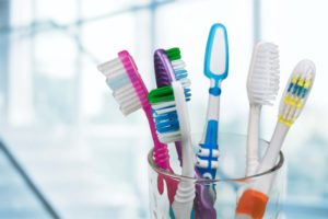 Assortment of toothbrushes in cup