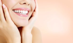Woman with a beautiful smile from cosmetic dentist in Melbourne.
